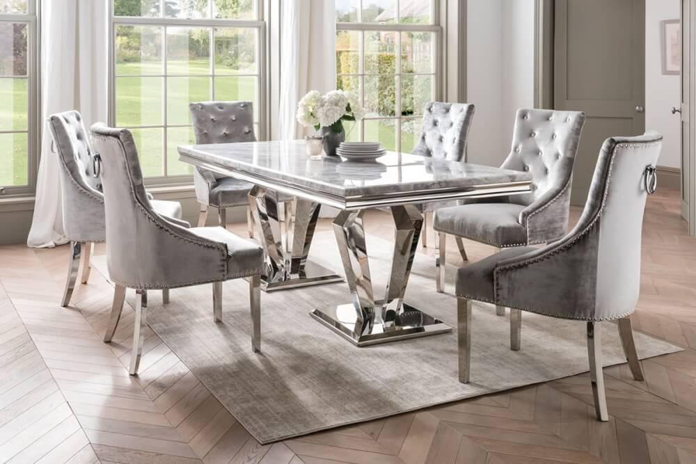 Hình ảnh cận cảnh bộ bàn ăn mặt đá nhân tạo màu xám trắng