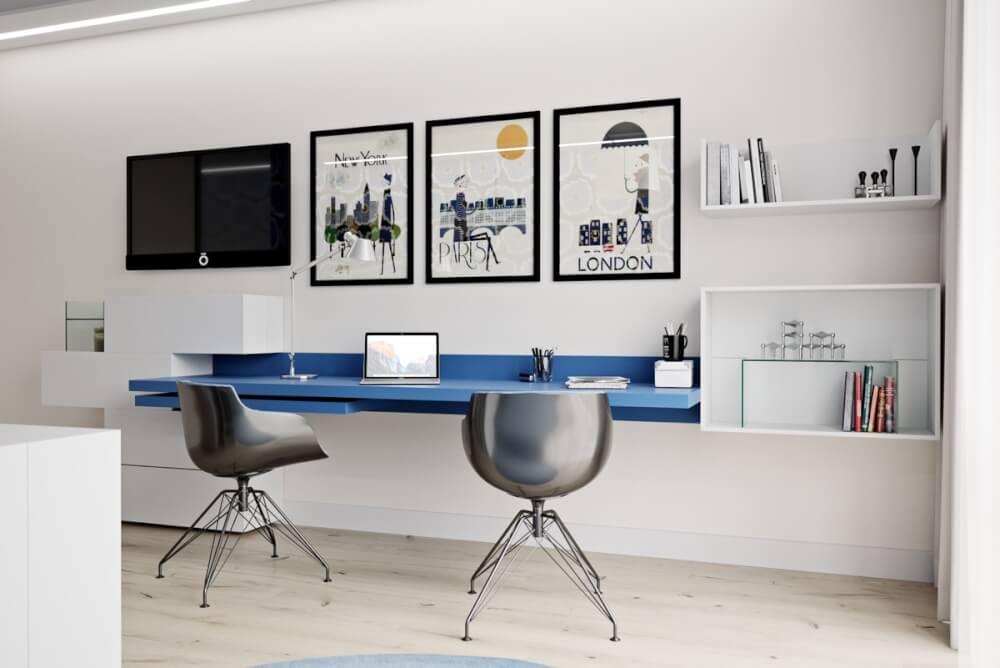 Hình ảnh cận cảnh góc làm việc tại nhà cho hai người với bàn màu xanh dương gắn tường, ghế kim loại sáng bóng, tranh treo tường hút mắt