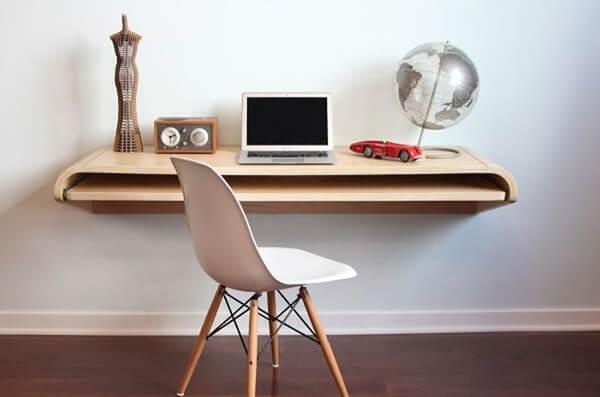Bàn làm việc cố định có mặt bàn kéo phía dưới mở rộng không gian làm việc