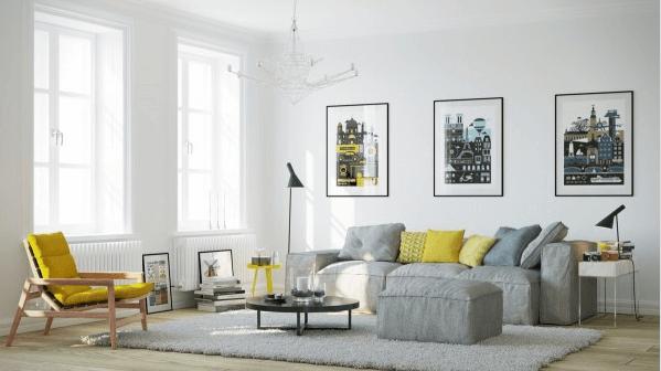 Hình ảnh phòng khách phong cách Bắc Âu với những điểm nhấn màu vàng tươi trẻ từ ghế thư giãn, gối tựa sofa, bàn phụ khiến phòng khách như bừng sáng