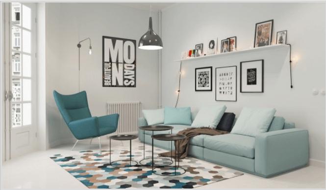 Hình ảnh phòng khách tươi sáng với sofa và ghế bành màu xanh ngọc lam đặt trên thảm trải họa tiết hình học bắt mắt