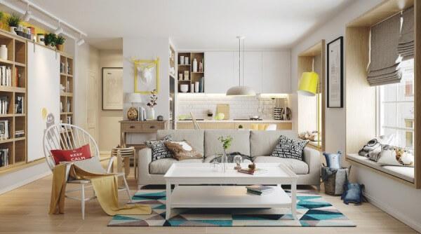 Hình ảnh phòng khách căn hộ Scandinavian với sofa xám, điểm nhấn màu xanh dương từ thảm trải, đèn chụp, khung tranh màu vàng