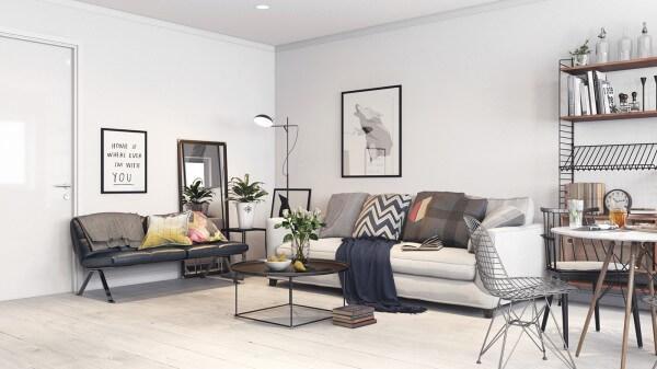 Hình ảnh phòng khách chuẩn phong cách Bắc Âu với sofa xám, bàn trà kính, tranh treo tường đen trắng, cạnh đó là phòng ăn