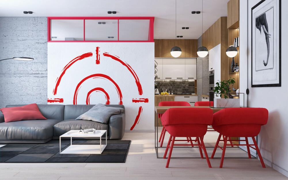 Hình ảnh toàn cảnh phòng khách và phòng ăn với điểm nhấn màu đỏ từ ghế ăn, tường nhà