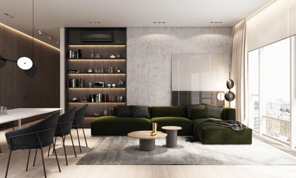 Hình ảnh phòng khách nổi bật với bộ ghế sofa màu xanh rêu, cạnh đó là phòng ăn