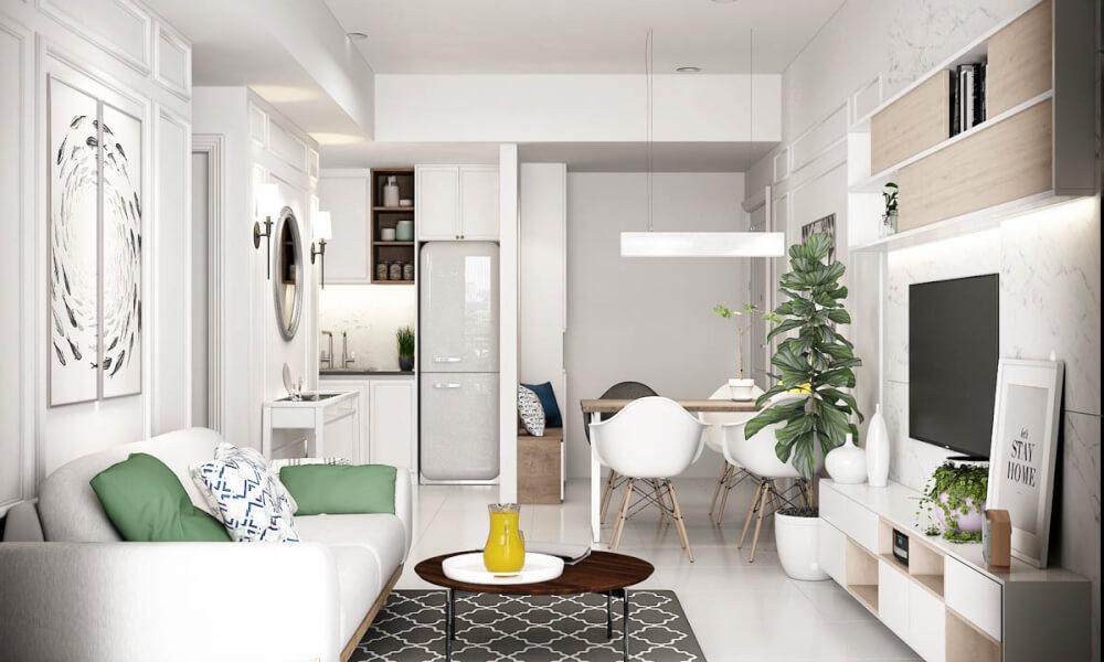 Hình ảnh căn hộ nhỏ màu trắng chủ đạo với điểm nhấn là cây xanh, gối tựa sofa