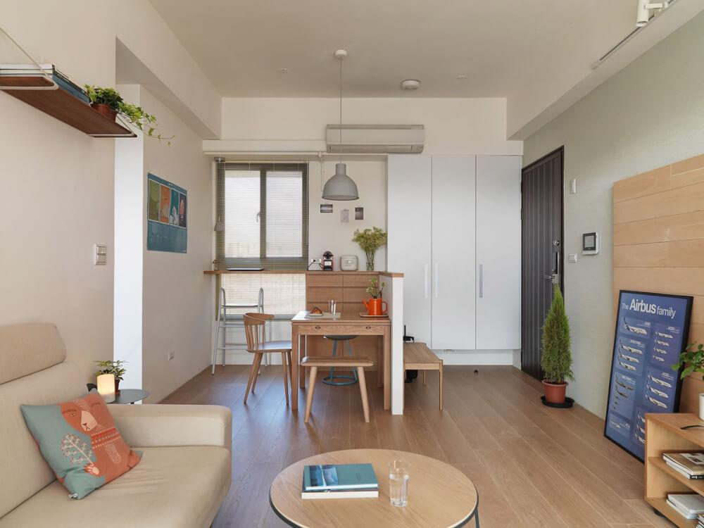 Hình ảnh thiết kế phòng khách kết hợp phòng ăn trong căn hộ chung cư với nội thất gỗ màu sáng