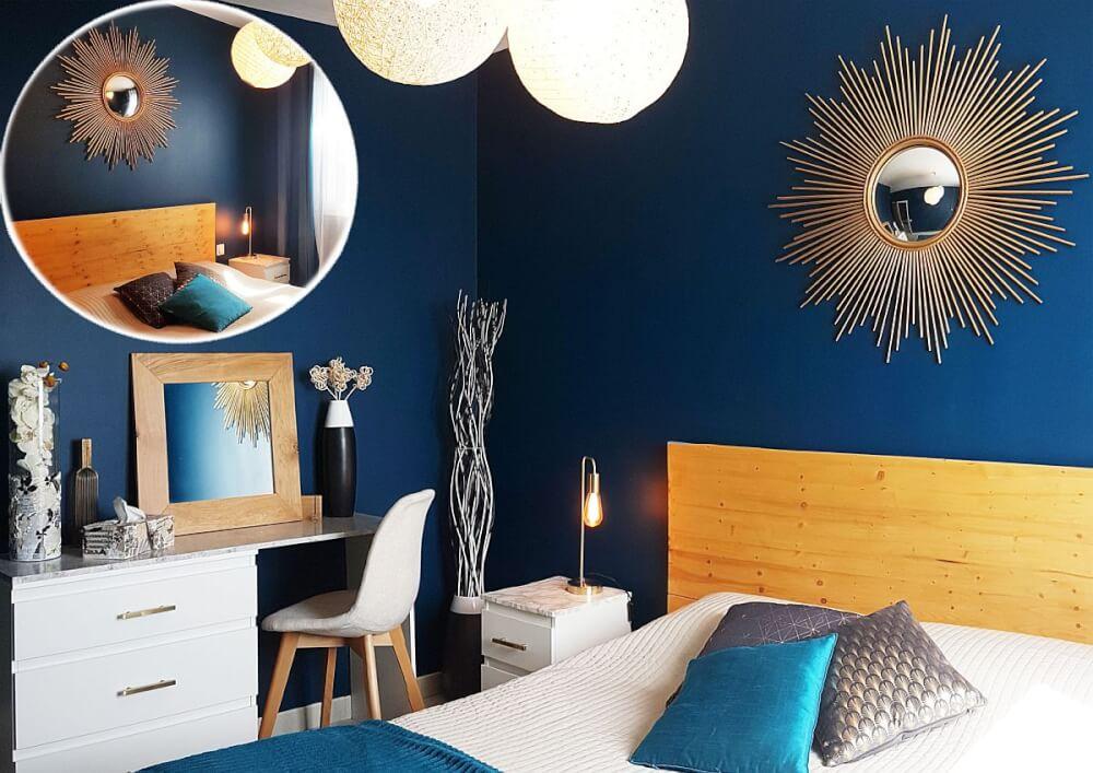 Hình ảnh phòng ngủ màu xanh dương đậm kết hợp nội thất gỗ, gương mặt trời trang trí