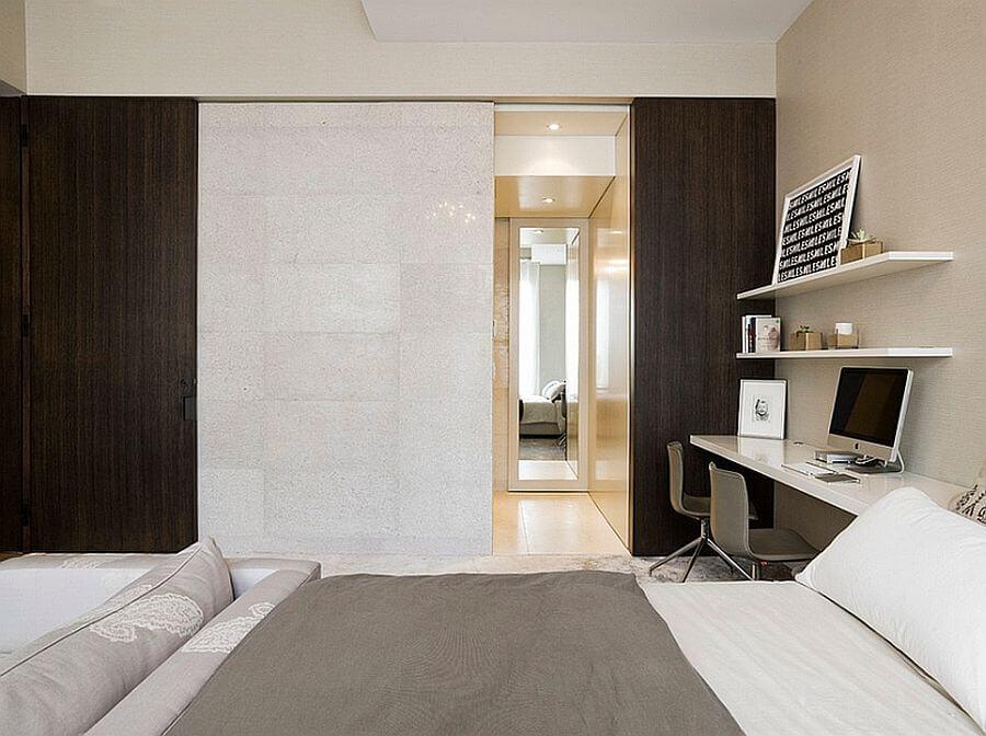 Hình ảnh một góc phòng ngủ với hệ kệ nổi gắn tường thành góc làm việc