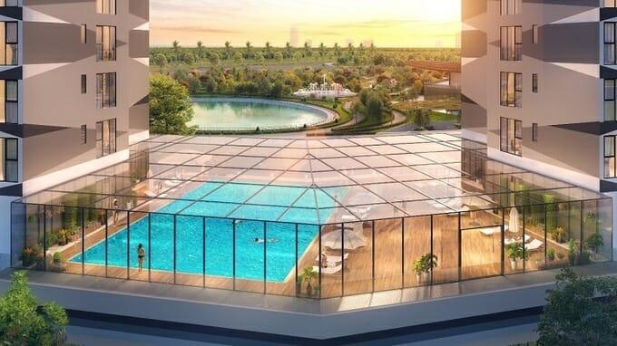 Bể bơi 4 mùa nằm ngay cầu nối giữa 2 tòa tháp tại tầng 4 với tầm nhìn ra công viên hồ điều hòa
