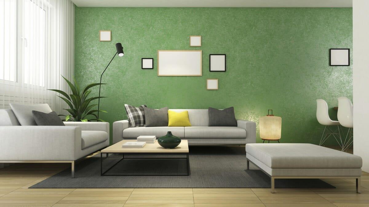 hình ảnh phòng khách đơn sắc ấn tượng với bức tường màu xanh lá sáng bóng