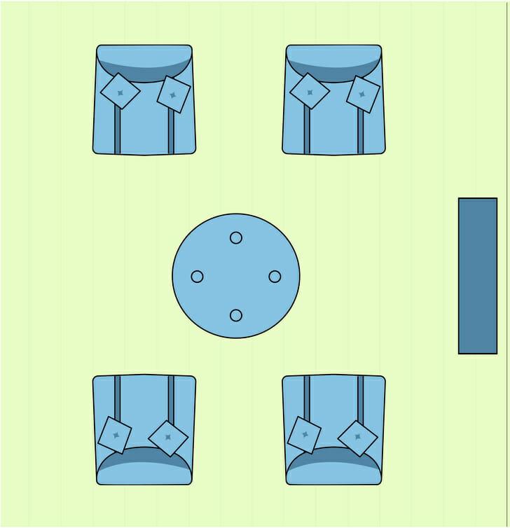 hình ảnh minh họa cho việc sắp xếp sofa, ghế bành phòng khách nhỏ đối diện nhau qua bàn trà trung tâm
