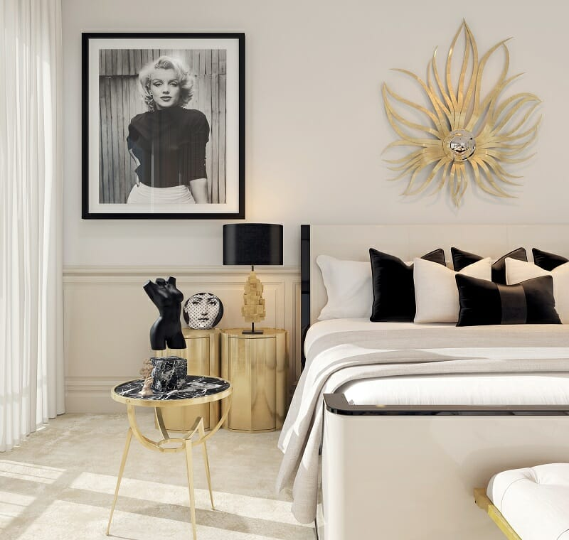 hình ảnh phòng ngủ phong cách Art Deco ấn tượng với phụ kiện trang trí đầu giường hình mặt trời tỏa nắng, tranh chân dung cô gái màu đen trắng, bàn trà tròn