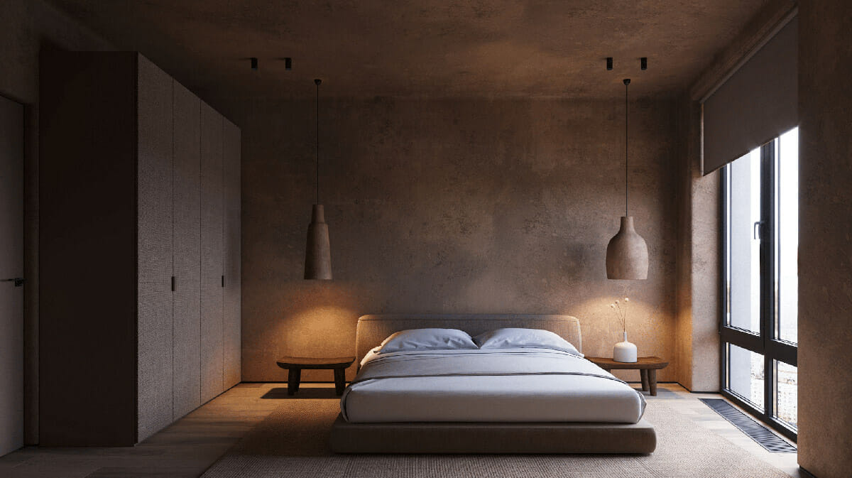 hình ảnh phòng ngủ với tường và trần màu nâu, giường gỗ thấp, tủ quần áo, đèn thả hai bên đầu giường