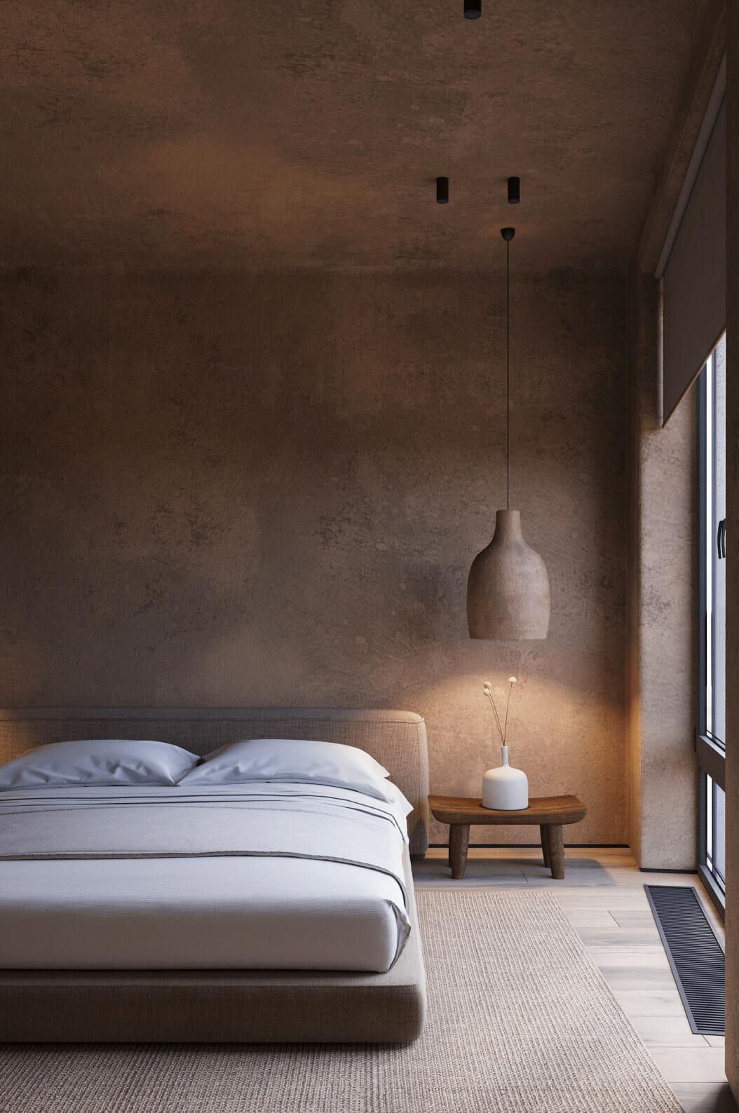 hình ảnh một góc phòng ngủ với giường thấp, đầu giường trang trí bình gốm trắng, đèn thả