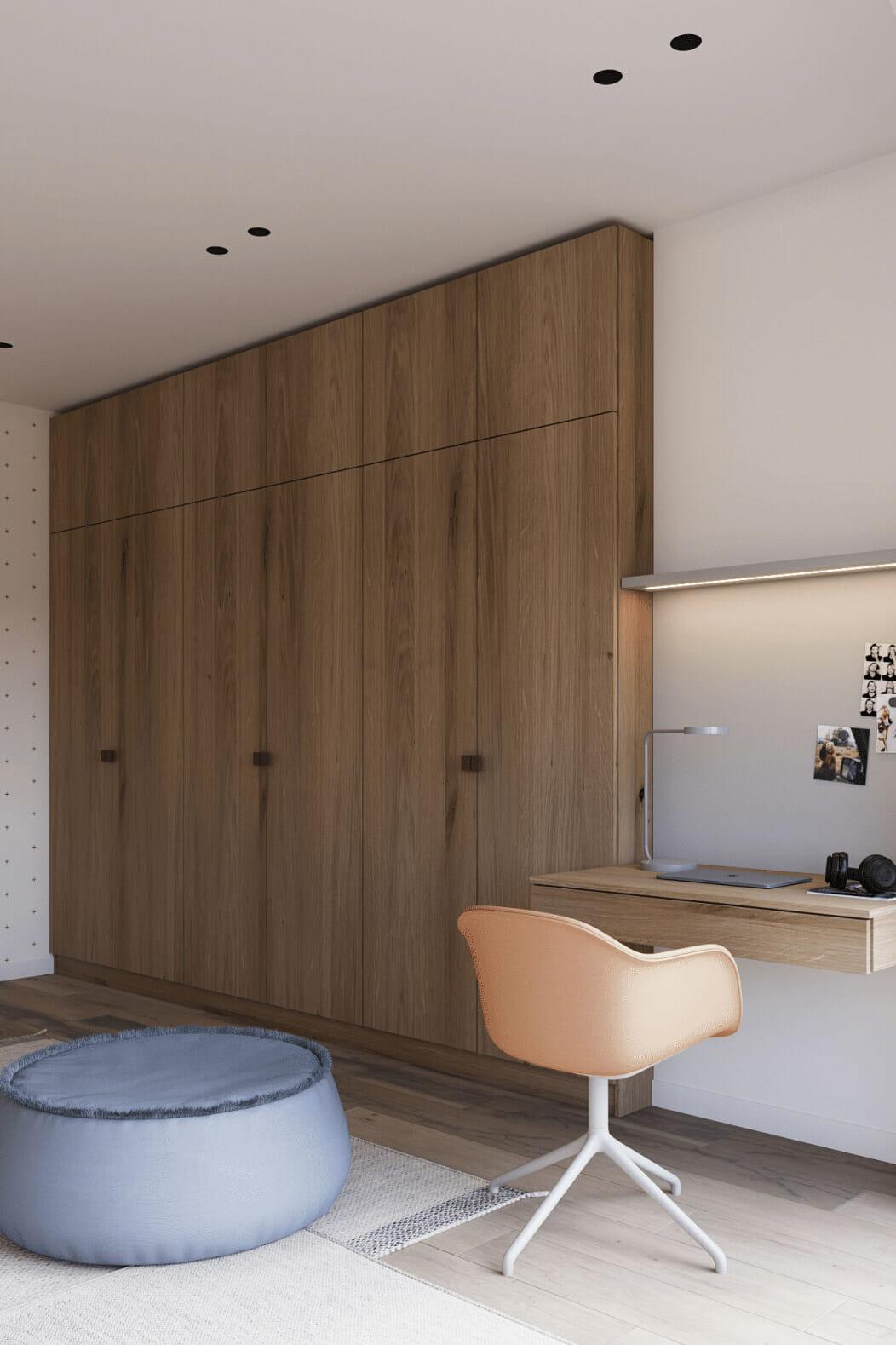 hình ảnh cận cảnh góc học tập, làm việc trong phòng ngủ nổi bật với ghế xoay màu cam
