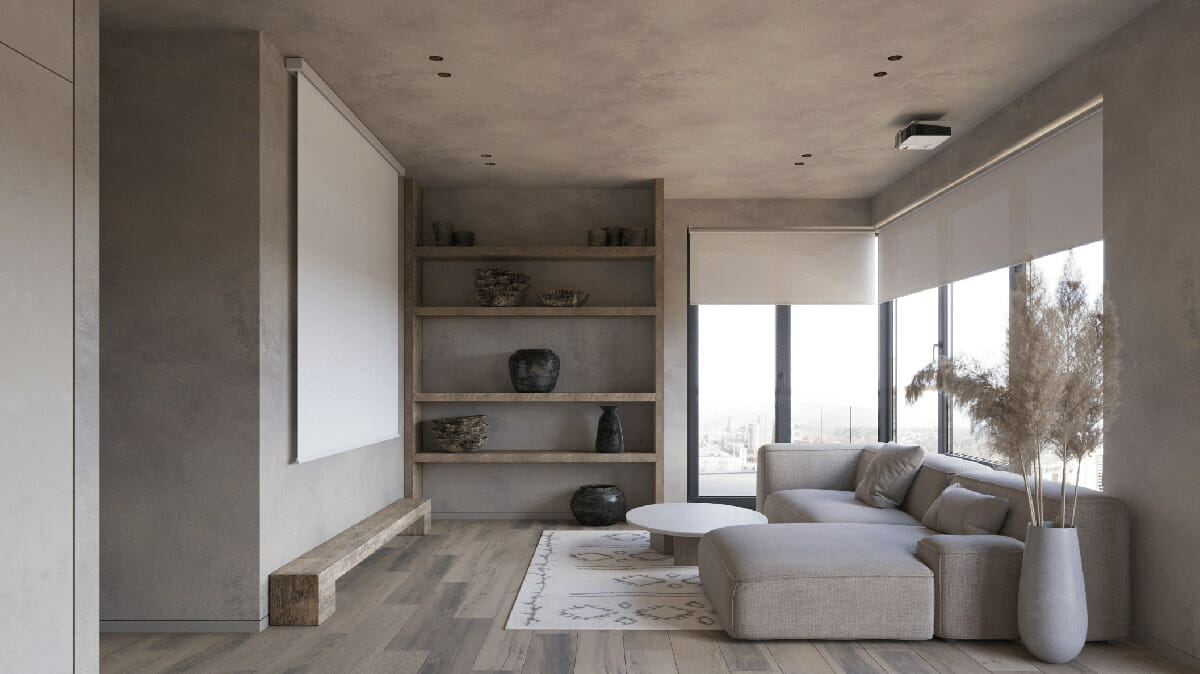 hình ảnh toàn cảnh phòng khách phong cách Wabi-Sabi với sofa màu ghi xám, kệ gỗ gắn tường, bàn trà tròn, bình lau lớn