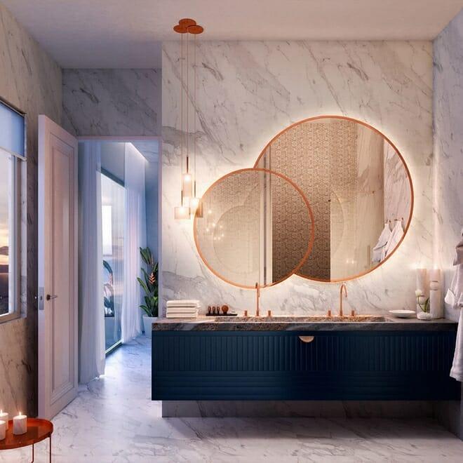 hình ảnh góc phòng tắm hiện đại nổi bật với bộ đôi gương tròn treo tường có khung viền màu cam