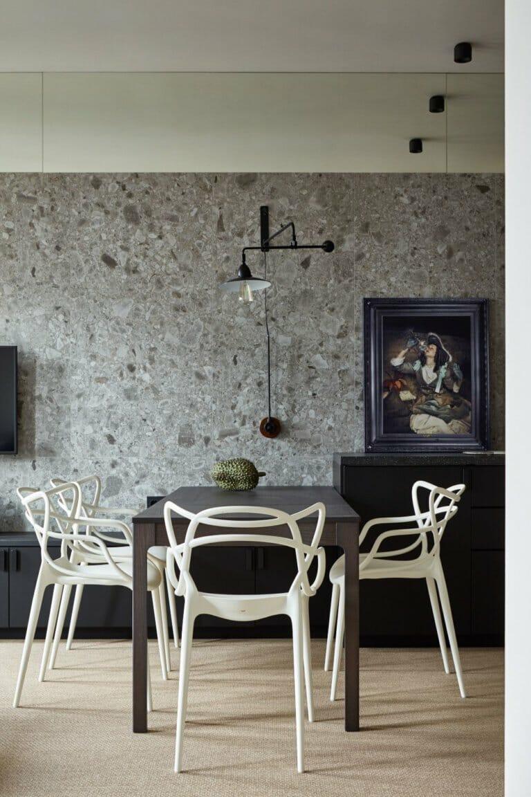 hình ảnh phòng ăn tối giản với bàn chữ nhật màu đen, ghế trắng kiểu dáng mới lạ
